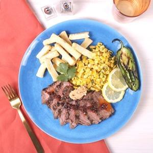 Spicy Chipotle Steak Frittes with Yuca Fries and Cilantro Corn