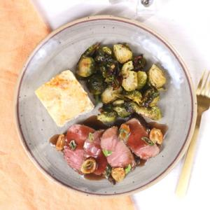 Garlic Roasted Lamb with Au Gratin Potatoes and Brussel Sprouts