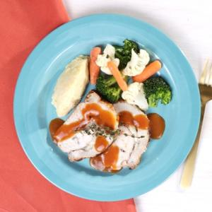 Manchego Pork Loin with Mashed Potatoes and Cal Vegetables