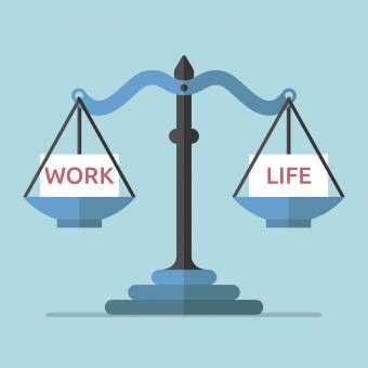 scale with the word work on one side and the word life on the other side