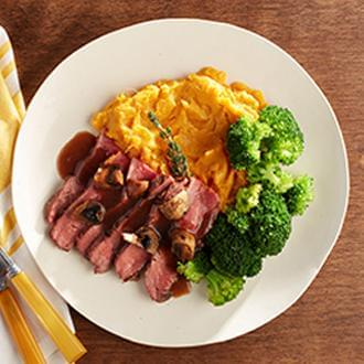 Sliced Flank Steak with Mushroom Sauce with Sweet Potatoes with Cauliflower Florets